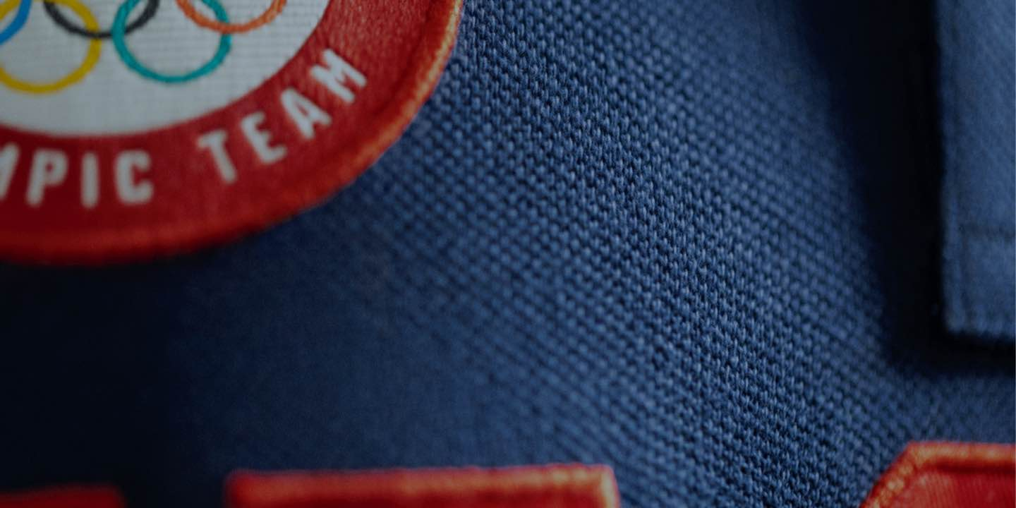 Close-up of Olympics patch sewn onto garment.
