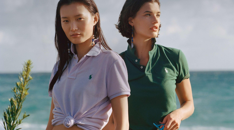 Women in light pink & green Earth Polos