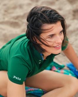 Woman in green Earth Polo on beach