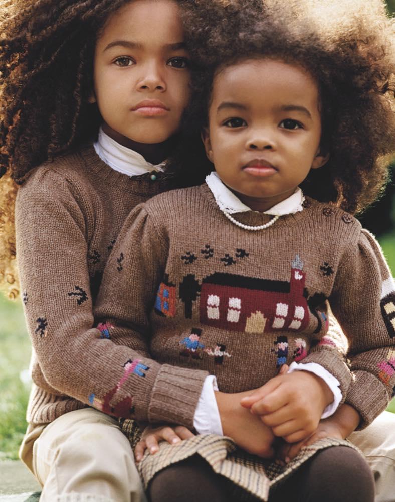 Sisters wearing knit vintage - inspired schoolhouse sweaters