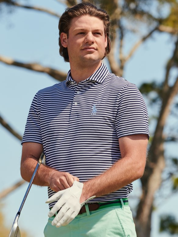 Man in golf Polo shirt with thin navy stripes