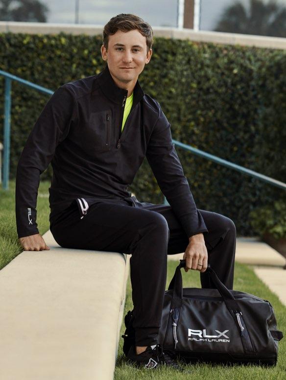 Golfer with black RLX duffel bag