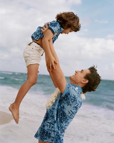Father & son on beach in matching Hawaiian Earth Polos