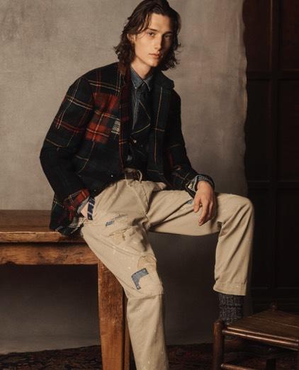 Man in patchwork tartan sport coat & distressed chinos