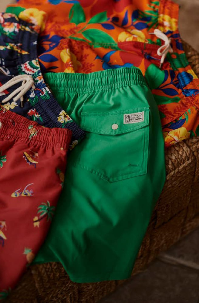 Colorful swim trunks in various patterns, prints & hues