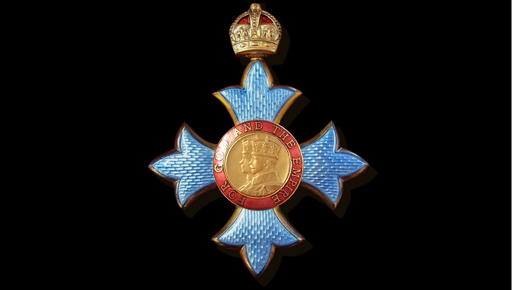 Close-up image of honorary knighthood medal.