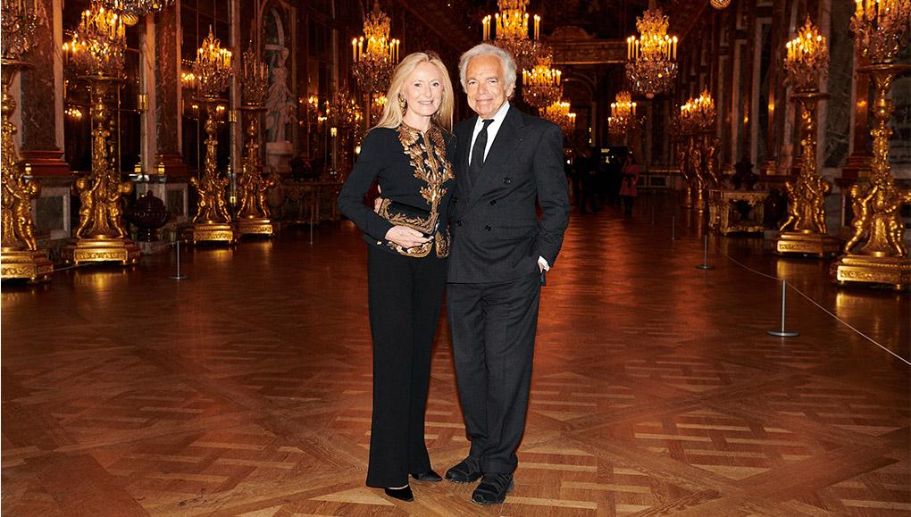 Ricky and Ralph Lauren in formal attire in Versailles ballroom.