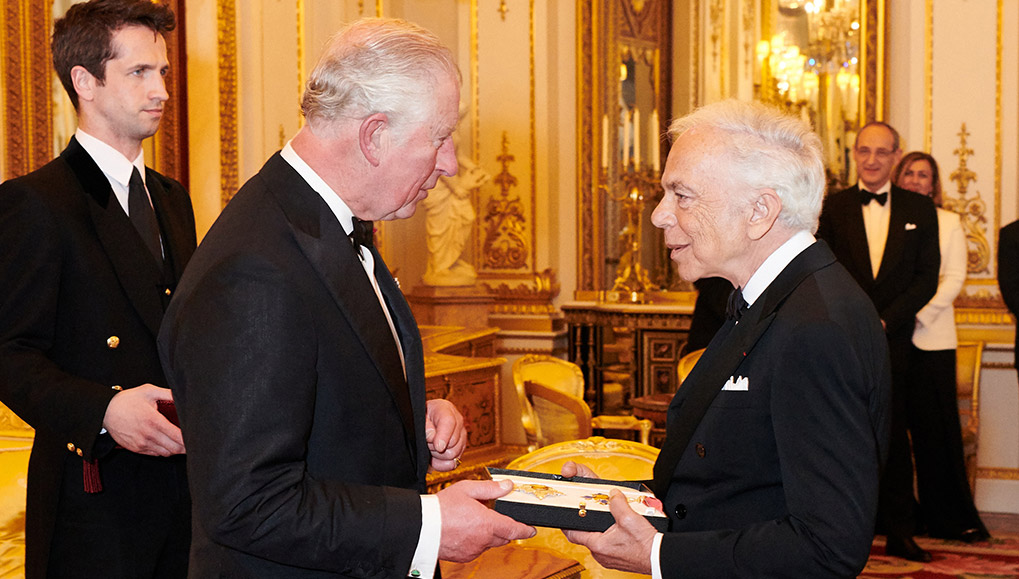 Ralph Lauren being presented with the knighthood insignia at Buckingham Palace
