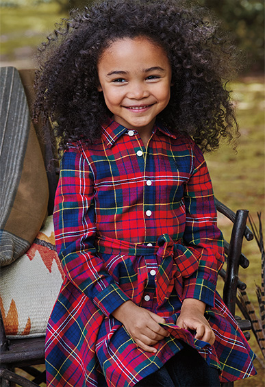 Girl in vibrant plaid shirtdress with tie-front