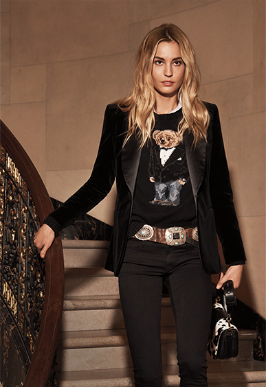 Woman in velvet blazer layered over Tuxedo Polo Bear sweater