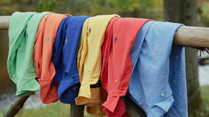 Colorful workshirts draped over fence